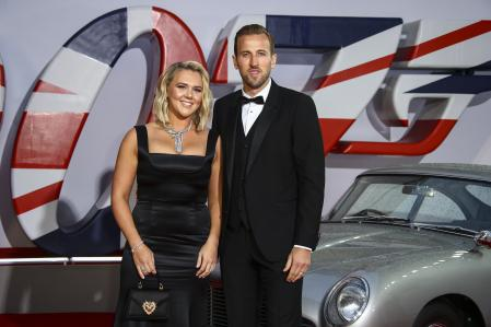 Football player Harry Kane and his wife Katie Goodland with the legendary James Bond Aston Martin, at the premiere of