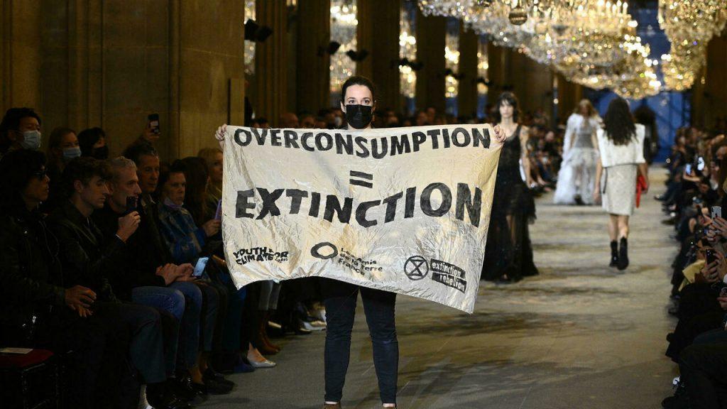 Climate change activists storm Louis Vuitton fashion show in Paris