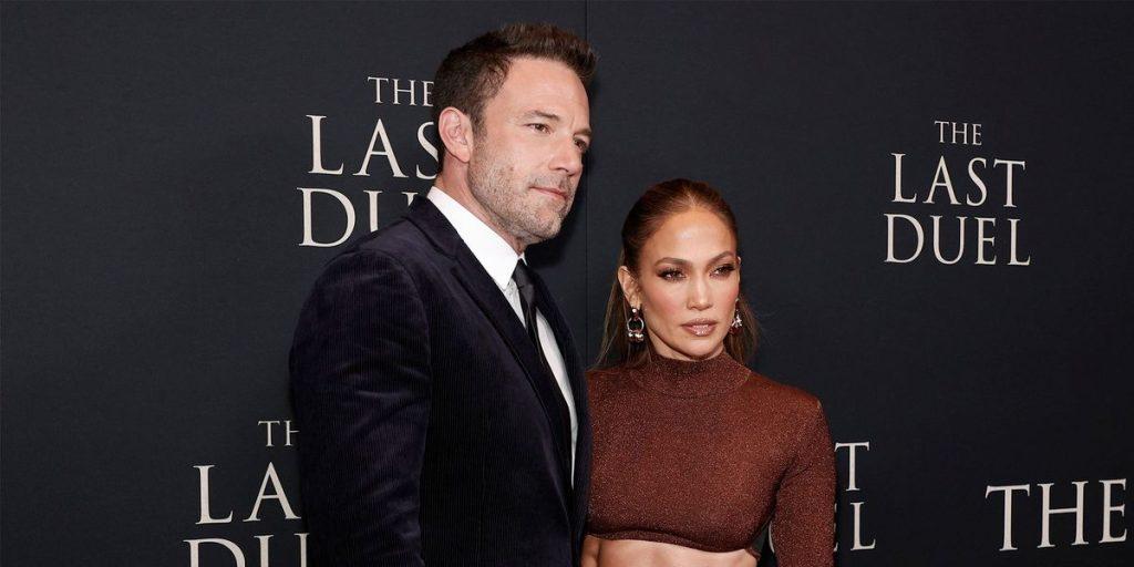 """Jennifer Lopez wears a """"short blouse"""" and a sparkly slit skirt"""