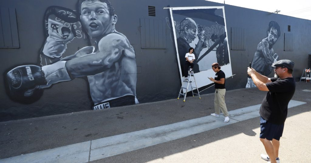 A mural celebrating Canillo, Pacquiao and San Diego businessman