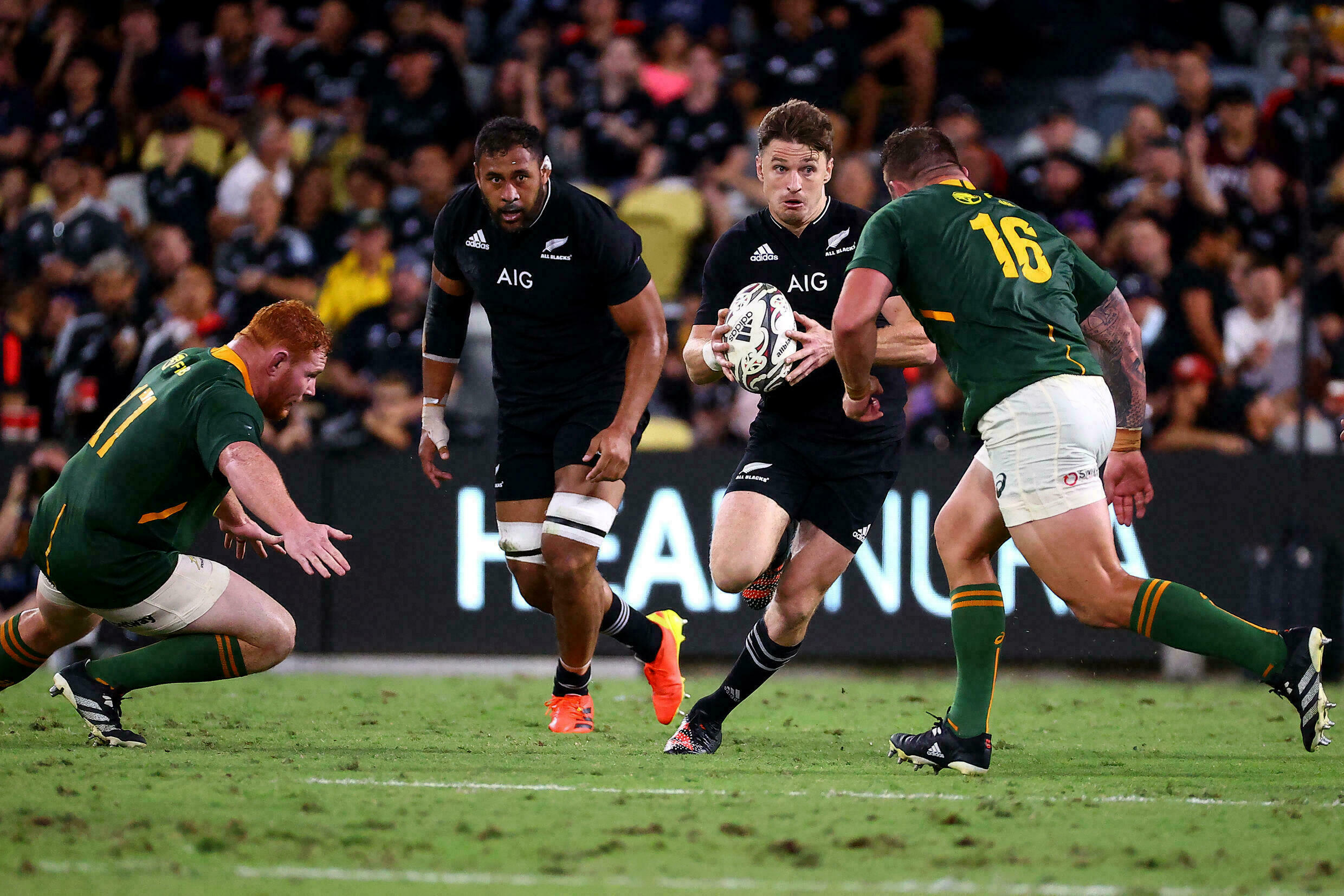 Two South African players prepare to cut off New Zealand's Baden Barrett during a game against South Africa on September 25, 2021 in Downsville, Australia.